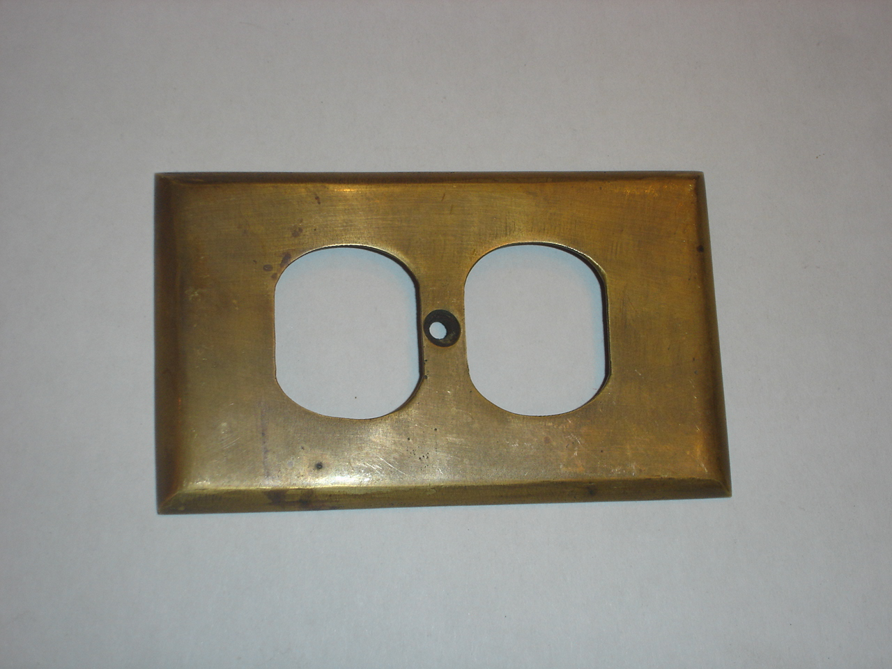 Brass switch cover Code AE.049 size L:115 mm W: 71 mm.